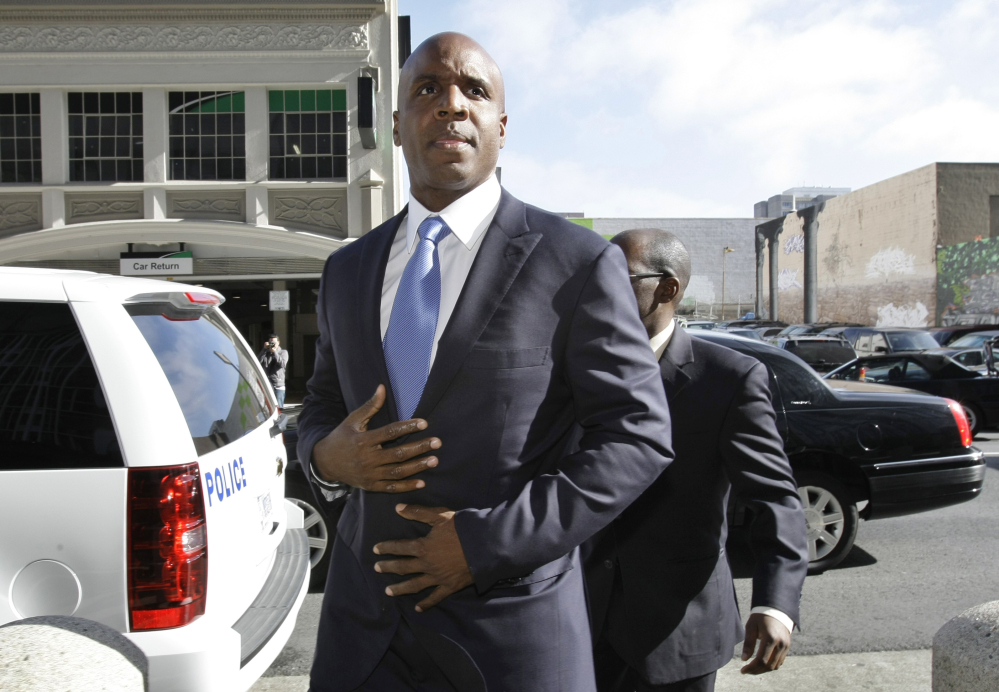 AP photo   In this Thursday, June 23, 2011, file photo, former San Francisco Giants slugger Barry Bonds arrives for a hearing about his perjury trial at the federal courthouse in San Francisco. The U.S. Department of Justice formally dropped its criminal prosecution of Barry Bonds, Major League Baseball's career home run leader.