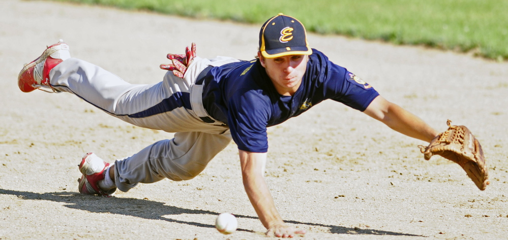 Staff photo by Joe Phelan   Augusta second baseman Justin Rodrigue dives but just misses a line drive by Gardiner's Eli Fish during a Zone 2 American Legion quarterfinal game Tuesday at Oak Hill High School in Wales. Augusta won 5-4.