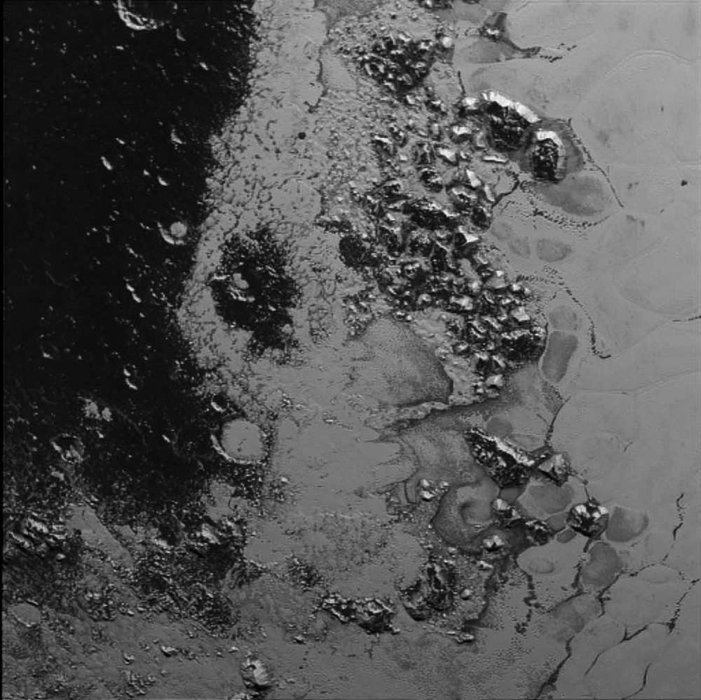 In this photo taken by New Horizons on July 14 from a distance of 48,000 miles, features as small as a half-mile across are visible on the surface of Pluto. The frozen mountain peaks are estimated to be one-half mile to one mile high, about the same height as the Appalachian Mountains.