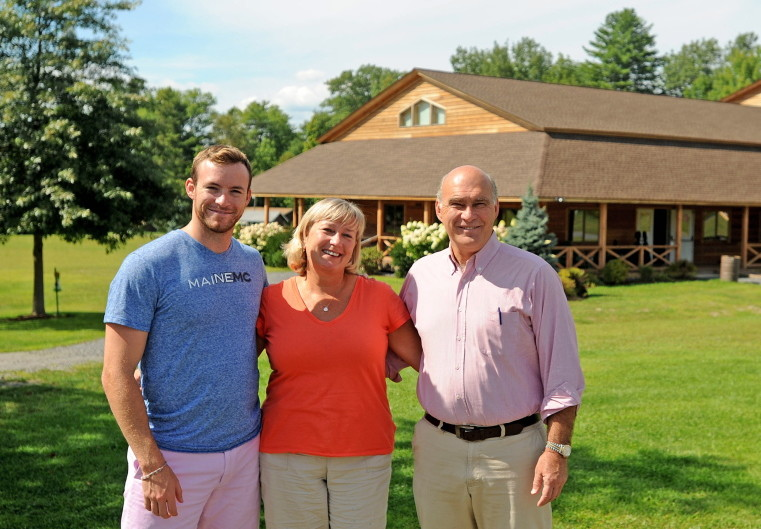 John and Kim Wiggin stand with their son Matthew at the New England Music Camp in Sidney on Aug. 20, 2014.