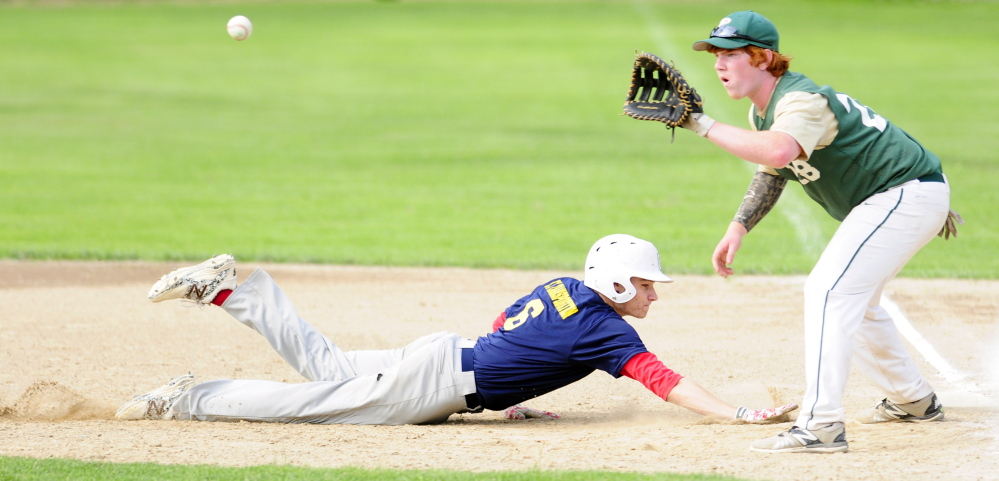 Augusta baserunner Justin Rodrigue dives back in time to beat a pick-off throw to Bessey first basemen Emery Chickering during a Zone 2 American Legion playoff game Thursday at McGuire Field in Augusta.