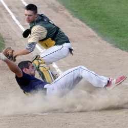 Augusta baserunner Tayler Carrier slides safely home to score the second of two runs on a hit by teammate Taylor Lockhart during a Zone 2 American Legion playoff game Thursday at McGuire Field in Augusta. The throw to Bessey catcher Matt Smith wasn't in time to get him out.