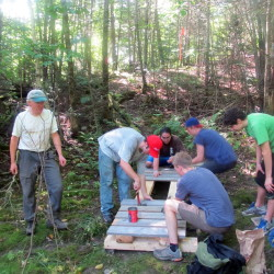 Volunteers at last years' event work on the Trout Brook deck house.