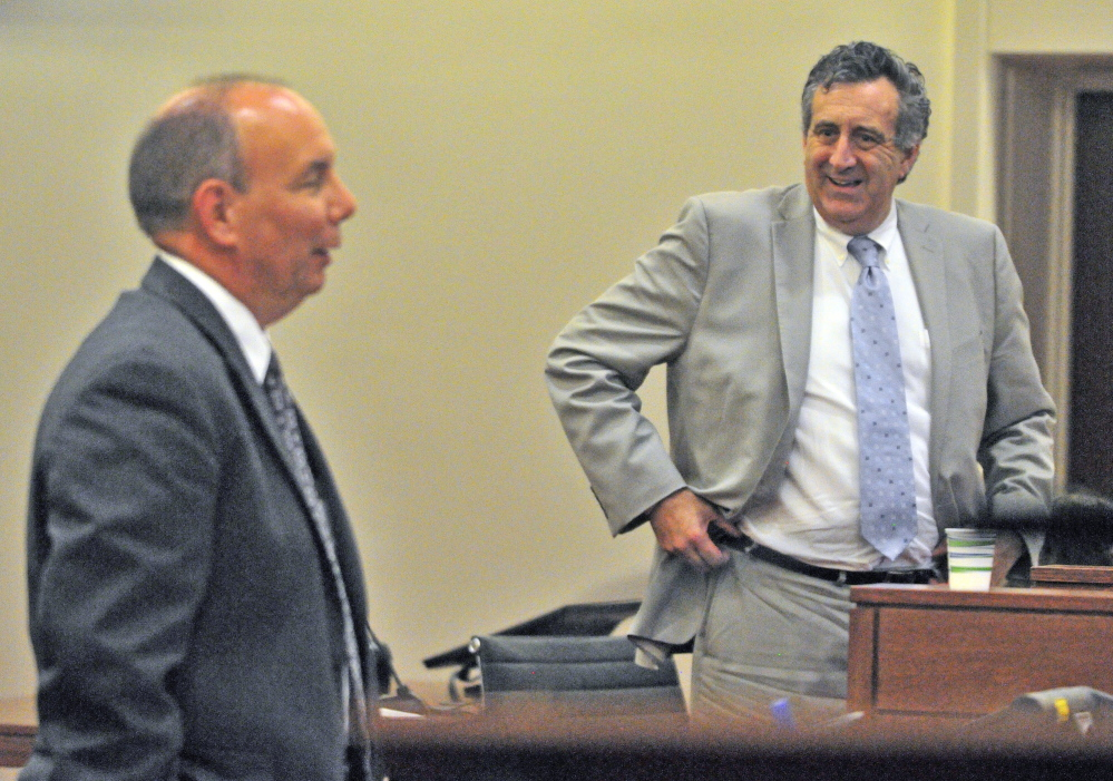 Assistant Attorney General Paul Rucha, left, and defense attorney Ronald Bourget argue during a Eric Bard's sentencing hearing on Friday in the Capital Judicial Center in Augusta.