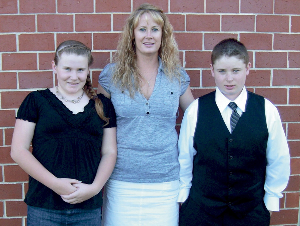 Amy Lake, with her two children, Monica and Coty, who were all killed in June 2011.