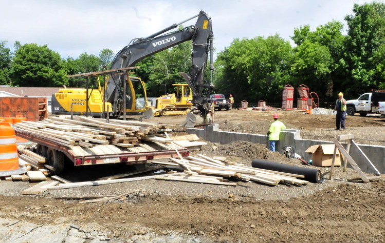 Construction workers build the foundation for the new Newport public safety building on Water Street on Monday.