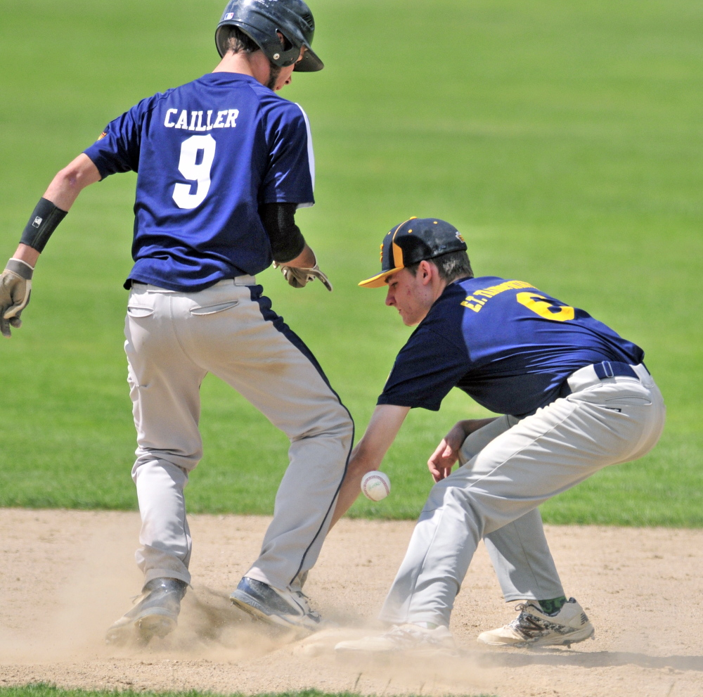 Staff photo by Joe Phelan   Tri-Town base runner Ethan Cailler, left, gets back to second base as the ball gets past Kolbe Merfeld during an America Legion Zone 2 tournament game Friday at Morton Field in Augusta.