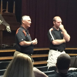 Staff photo by Randy Whitehouse   Gardiner athletic director Steve Ouellette, left, and new football coach Joe White talk to parents and players Saturday morning at the high school.