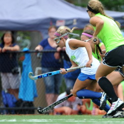 Staff photo by Michael G. Seamans  Falmouth High School's Elle Fitzgerald, middle, leads the pack in pursuit of a loose ball during the all-star game Saturday at the Maine Field Hockey Festival at Thomas College. The West prevailed 2-1.