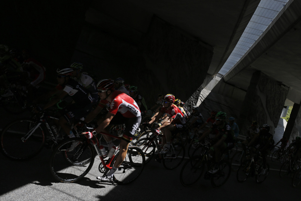 The pack passes through a tunnel during the twentieth stage of the Tour de France cycling race over 110.5 kilometers (68.7 miles) with start in Modane and finish in Alpe d'Huez, France, Saturday.