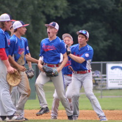 Members of the Augusta 15U Babe Ruth team, including Cole Lockhart, Jake Hendsbee, Dylan Presby, Isaiah Magee, Cody Taylor and Jake Wroton, celebrate after they defeated Cranston, R.I., 2-1 in a New England Regional game Sunday morning at Trumbull (Conn.) High School.