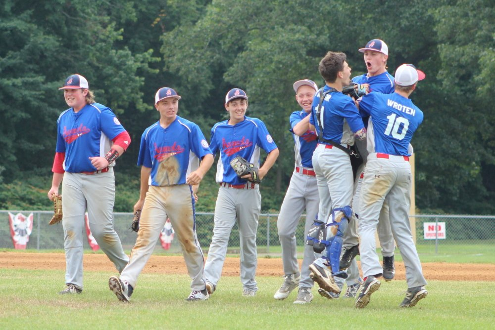 Members of the Augusta 15U Babe Ruth team celebrate their 2-1 victory over Cranston, R.I., on Sunday morning at Trumbull High School in Trumbull, Conn.