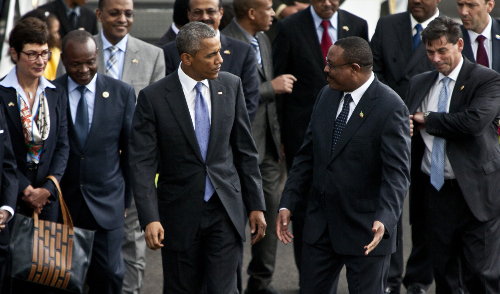 The Associated Press U.S President Barack Obama, left, walks with Ethiopian prime minister Hailemariam Desalegn, right, after his arrival at Bole International Airport, Addis Ababa, Ethiopia.