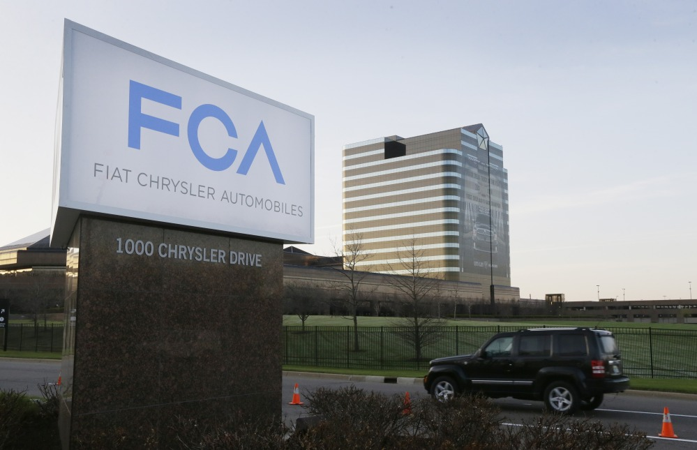 In this Tuesday, May 6, 2014, file photo, the Fiat Chrysler Automobiles sign is seen after being unveiled at Chrysler World Headquarters in Auburn Hills, Mich.