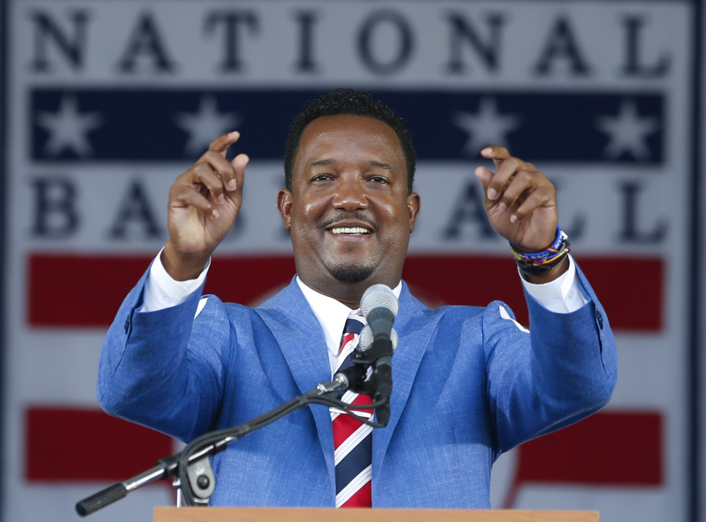 National Baseball Hall of Fame inductee Pedro Martinez speaks during an induction ceremony at the Clark Sports Center on Sunday in Cooperstown, N.Y.