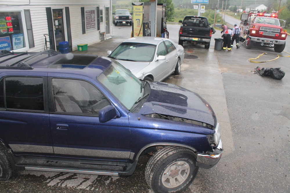 Police said a driver running a stop sign at Four Corners General Store in West Gardiner caused an accident involving three vehicles, including the blue Toyota SUV in the foreground and the silver Lincoln sedan behind it.