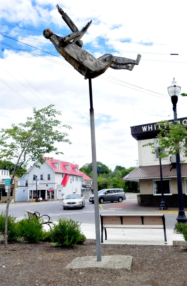 "The ""Falling Woman"" sculpture by Bernard Langlais now graces downtown Skowhegan on Thursday."