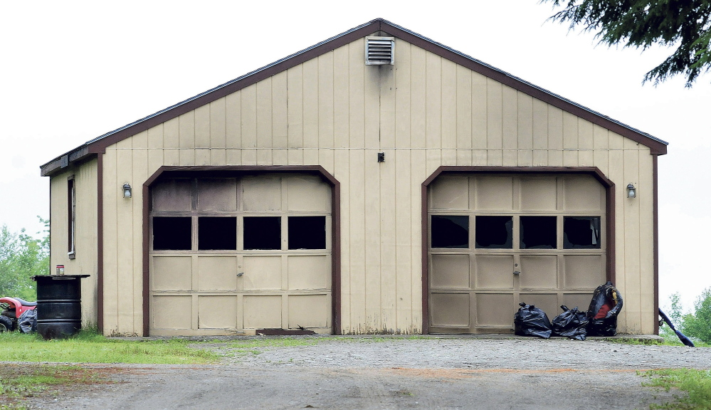 Smoke stains and broken windows mar this garage at 142 Waite Hill Road in Cornville on Monday, where homeowner Tony Kimball was burned and hospitalized after a Sunday fire.