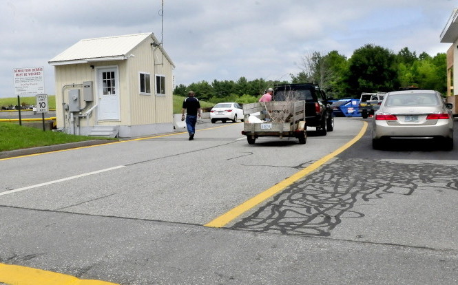 Residents arrive to drop off material debris, recyclable items and trash at the China transfer station on Monday. Selectmen are considering a pay-as-you-throw program.
