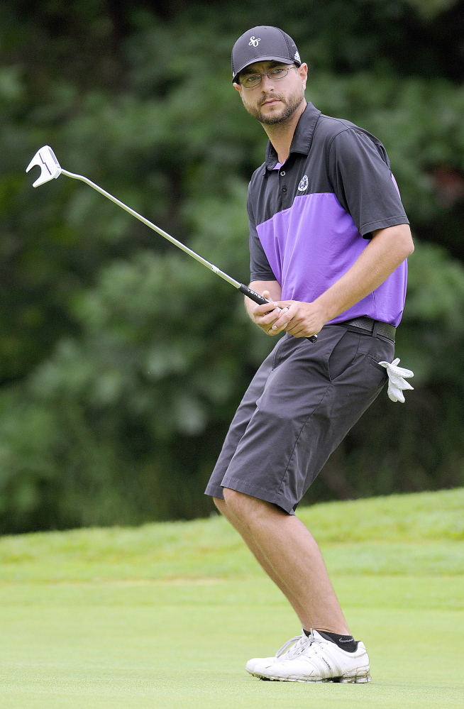 Staff photo by Andy Molloy   Ashley Fifield, of Westbrook, reacts to a putt during the the first round of the Charlie's Maine Open Monday at the Augusta Country Club in Manchester.