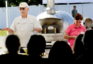 Michael Jubinsky explains the process of making bread in a wood-fired oven during a workshop in the 2013 Kneading Conference in Skowhegan as wife Sandy Jubinsky assists. This year's conference, hosted by the Maine Grain Alliance, begins Thursday.