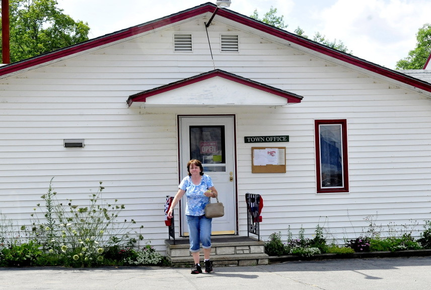 Resident Julia Greene leaves the Anson town office on Tuesday afternoon.