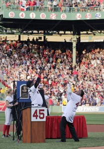 Baseball Hall of Fame member and former Boston Red Sox Pedro Martinez, right, and former teammate David Ortiz celebrate after Martinez's No. 45 was unveiled on the facade of the right field grandstands during a ceremony prior to a game on Tuesday against the Chicago White Sox at Fenway Park in Boston.