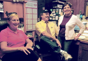 Sitting in a back room at Joseph's Market in Waterville on Thursday, business owner Kevin Joseph and his wife Diane, right, discuss funding the Festival of Falls along with coordinator Karen Rancourt-Thomas. The city cut funding for the September multi-cultural festival from the city budget, but the Josephs have made a contribution toward keeing the event alive and hopes over local businesses will too.