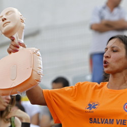 A paramedic holds a plastic CPR training mannequin while teaching volunteers how to perform CPR in Romania in 2011. While some countries mandate CPR training, less than 3 percent of the U.S. population receives instruction. Reuters