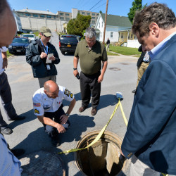 At left, Gov. Andrew Cuomo, right, and former prison Superintendent Steven Racette examine a manhole in Dannemora, N.Y., during the 23-day manhunt for David Sweat, above left, and Richard Matt.