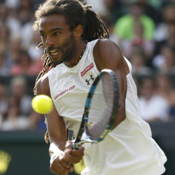 Dustin Brown of Germany returns a ball to Rafael Nadal of Spain during their singles match at the All England Lawn Tennis Championships in Wimbledon, London, on Thursday.