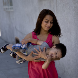 Joshua Tinoco's teenage mother, Dunia Bueso, has been told that her son is an immigration enforcement priority and should be sent back to his native Honduras even though she is being allowed to stay and seek a green card. The Associated Press
