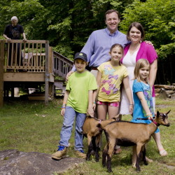 "The Eves clan in North Berwick includes Mark and his wife, Laura, their three children, from left, 8-year-old Lucas, 10-year-old Elaina and Naomi, 5, along with 11 chickens, two pigs and these two Oberhasli goats, Flint and Sprinkles. ""We decided (North Berwick) was the place we wanted to move ... and to start raising our own family,"" Eves said."