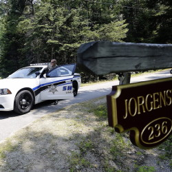 A day after the discovery of three bodies at two homes in Boothbay Harbor, Lincoln County Deputy Ryan Chubbuck is stationed at the entrance to the Jorgensen residence on Lakeside Drive.