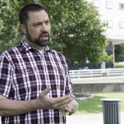 Jeremy Alcede talks about his legal issues Friday outside the federal courthouse in Houston.
