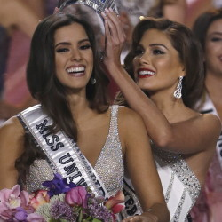 Reigning Miss Universe Gabriela Isler, right, crowns the new Miss Universe, Paulina Vega of Colombia, at the pageant in January.