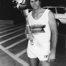 Bruce Jenner poses with the 1984 Olympic torch he carried through Lake Tahoe, Nev.