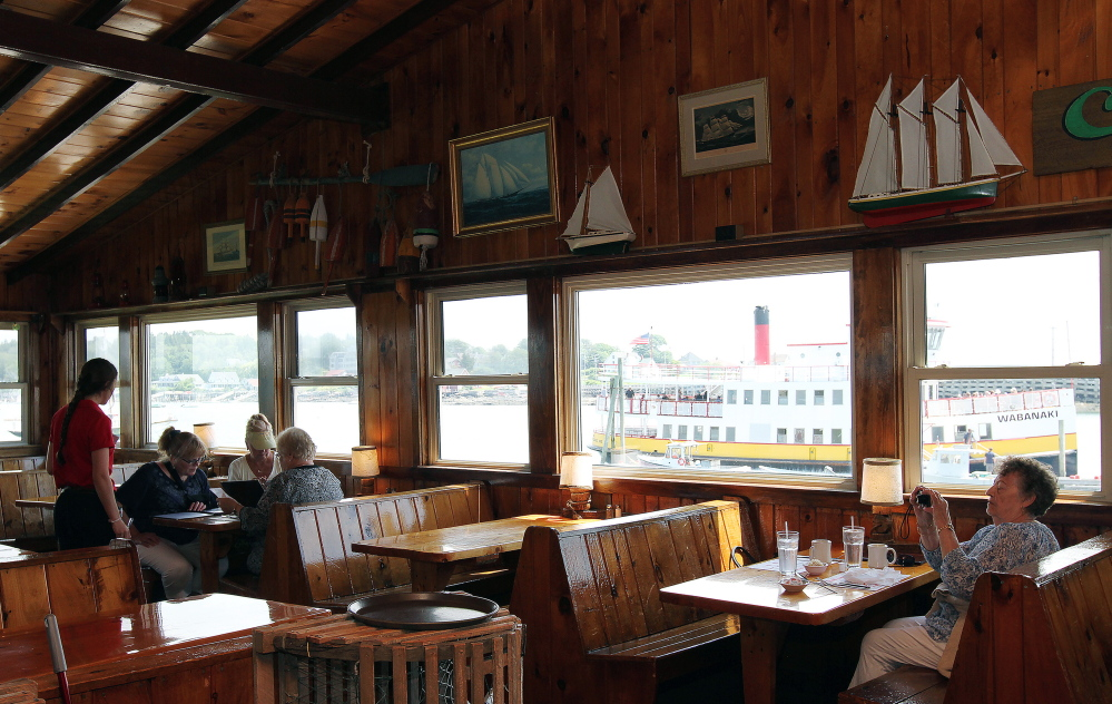 """A Casco Bay Line ferry sits outside Cook's Lobster House in Harpswell. Jen Charboneau, the new co-owner of the restaurant, plans to """"make what's there a little bit better."""""""