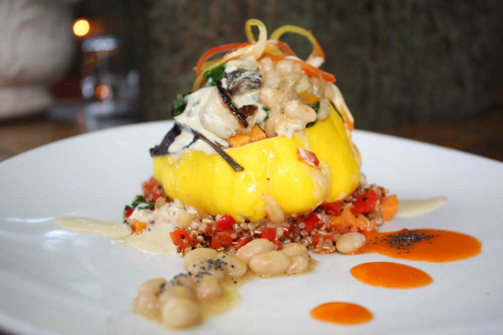 A recent off-menu vegan dish at Caiola's in Portland featured baby pattypan squash stuffed with charred vegetables on a bed of sweet red pepper quinoa and topped with a cream sauce made from white beans, almond milk and cashews.