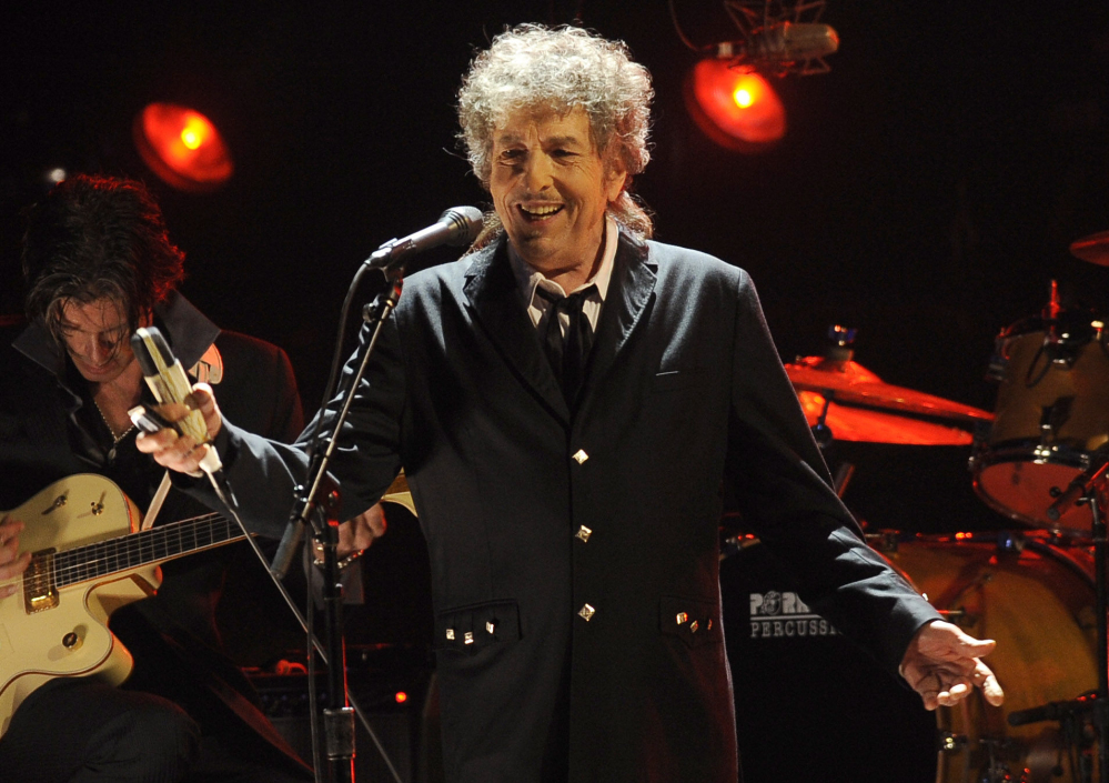 """Bob Dylan made rock history when he went electric at the Newport Folk Festival in 1965. At the 2015 festival he paid a tribute to the legendary moment with a secret lineup of musicians billed as """"65 Revisited."""""""