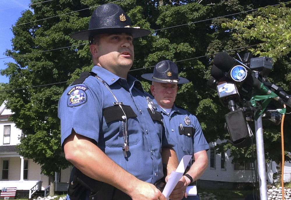 Maine State Police Lt. Sean Hashey, left, and Maj. Chris Grotton speak outside the police department in Lincoln.