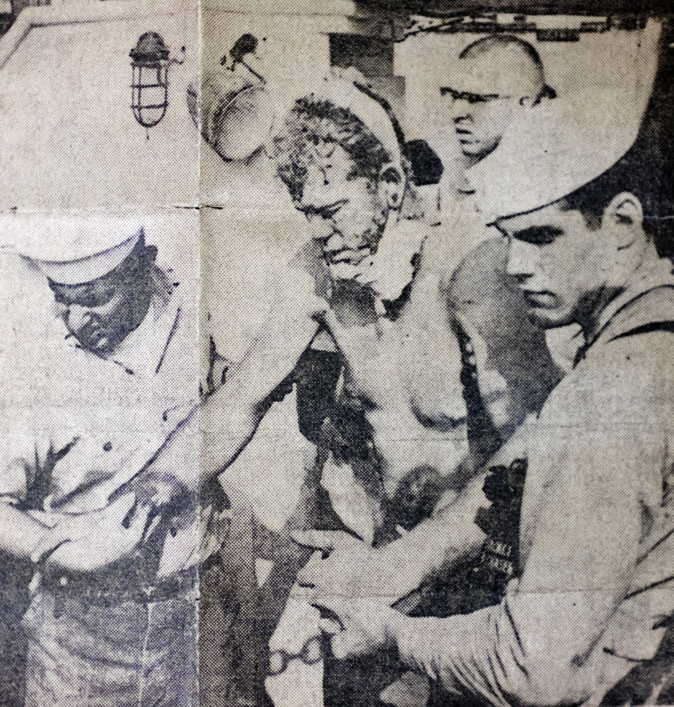 Peter Leavitt of Portland, shown being helped toward a stretcher at the Little Creek Coast Guard Station in Norfolk, Va., was one of the four crewman who survived.