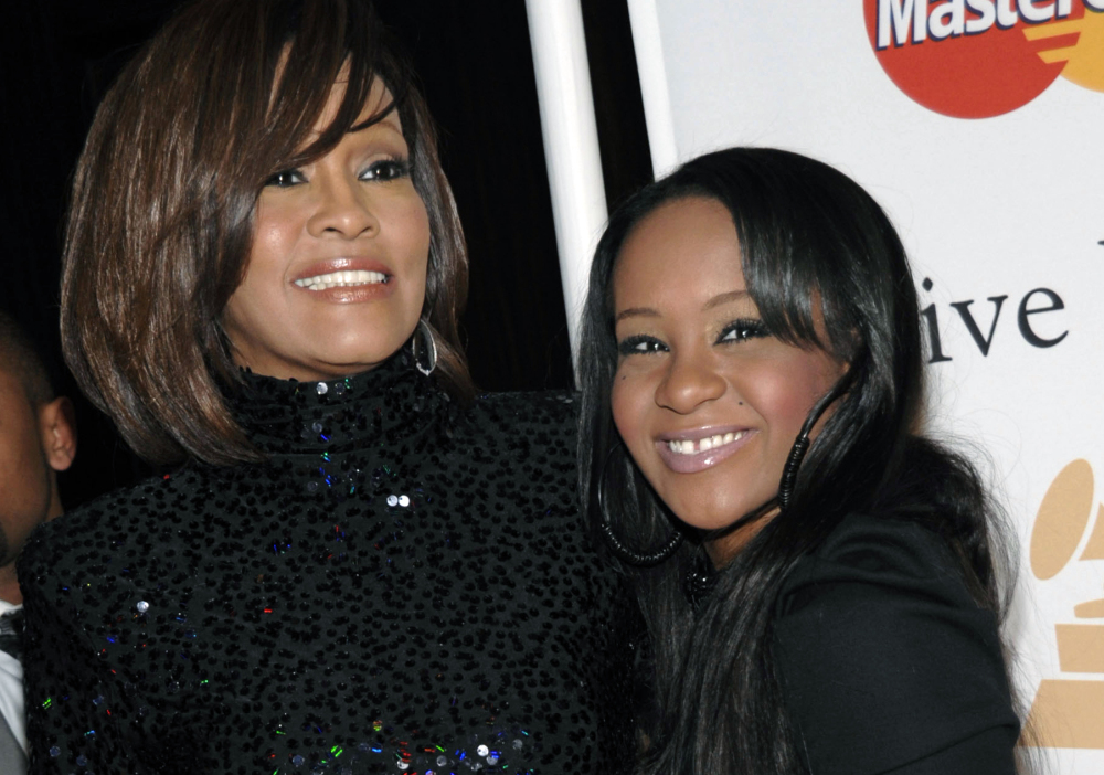 Whitney Houston, left, and daughter Bobbi Kristina Brown in 2011. Brown, who was in hospice after months of receiving medical care, died Sunday.