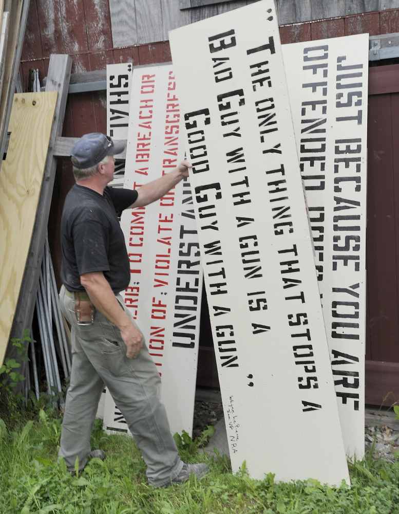 Linc Sample, a former Boothbay Harbor selectman, has an array of yard signs that he began posting in 2006, hand-painting each one with stencils.