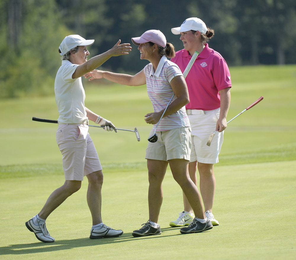 Staci Creech, center, is congratulated by Laurie Hyndman, left and Emily Bouchard, after winning the Maine Woman's Amateur  on Wednesday. Bouchard was second, seven strokes back.