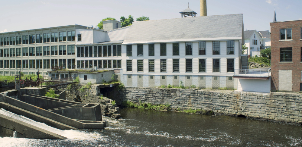The mill buildings once housed a furniture manufacturer, but now hold more than 20 apartments, several small offices, a restaurant and an inn. Much of the space has been leased as developers prepare for the grand opening Saturday.