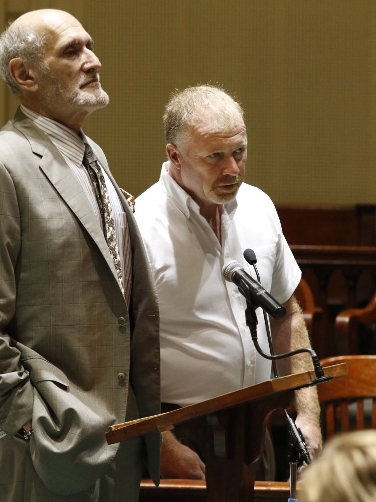 David Brown, right, the driver in last year's fatal hayride crash in Mechanic Falls, appears in court Thursday with his attorney Leonard Sharon. Brown pleaded not guilty to a misdemeanor charge of reckless conduct.