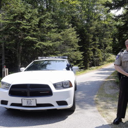 The day after the discovery of three bodes at two homes in Boothbay Harbor, Lincoln County Deputy Ryan Chubbuck is stationed at the entrance to the Jorgensen residence on Lakeside Drive.