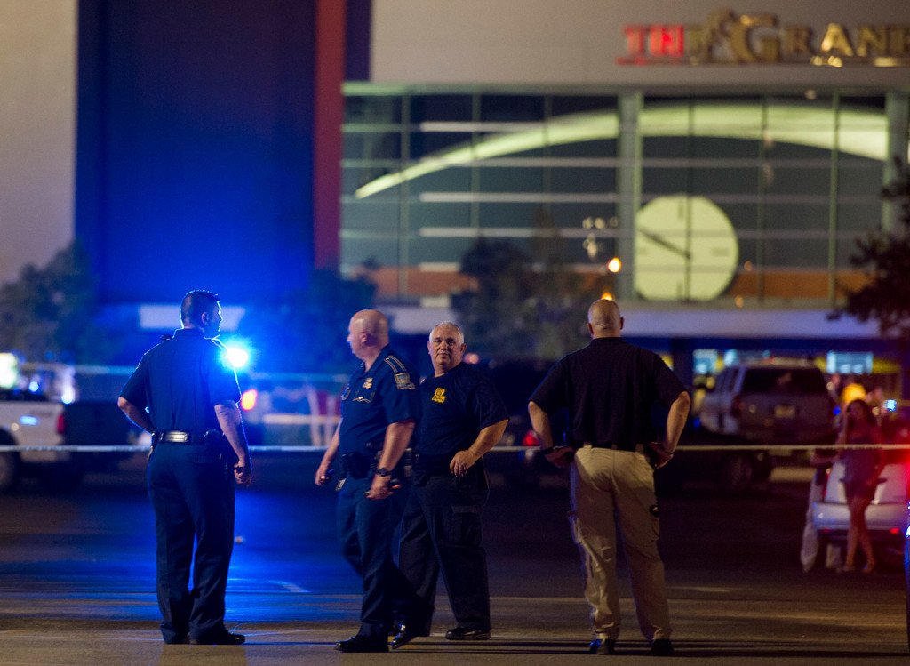 Police gather at The Grand Theatre following a deadly shooting in Lafayette, La., Thursday night.