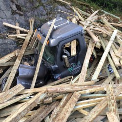 A tractor-trailer loaded with 90,000 pounds of lumber, ran off Interstate 95 in Sidney at mile 115 in the northbound lane.  Nearly all of the wood broke loose from the trailer after it slammed into the rock ledge.
